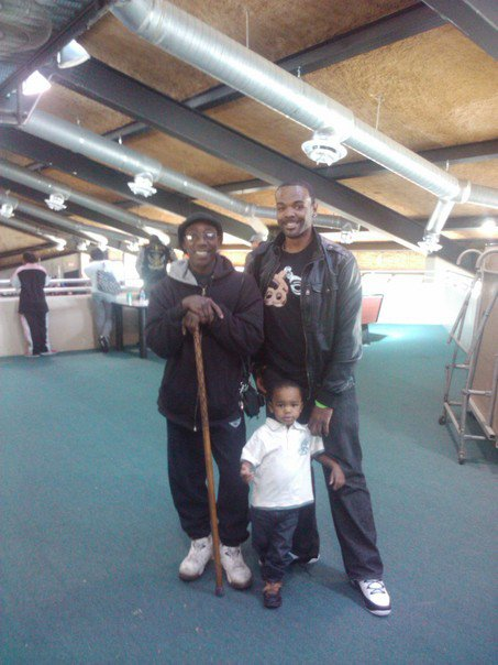The grandmaster and myself (along with my son) several years ago.